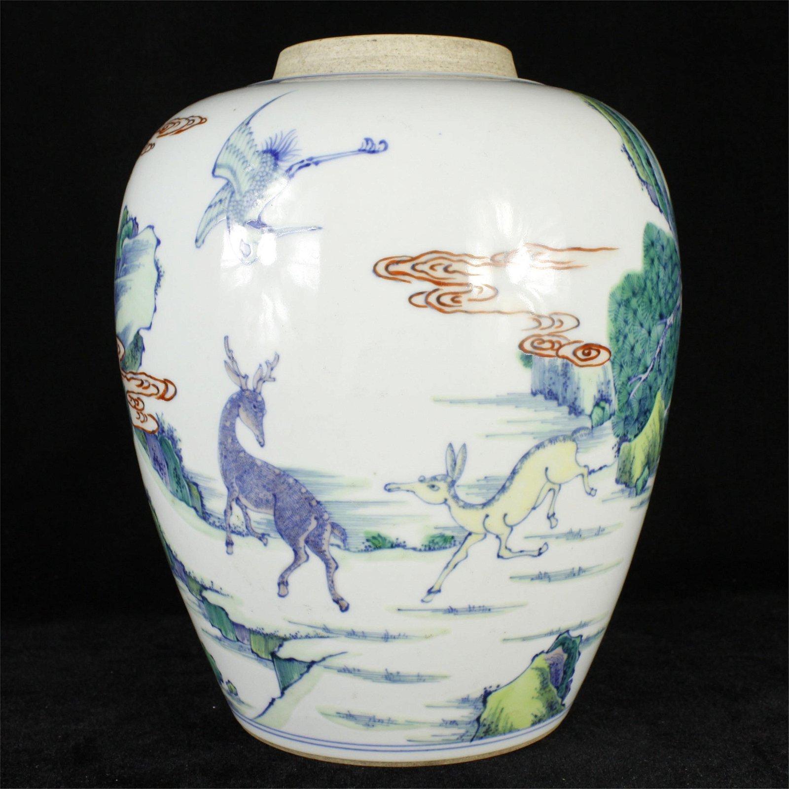A CHINESE PORCELAIN DOU CAI DEER AND CRANE JAR