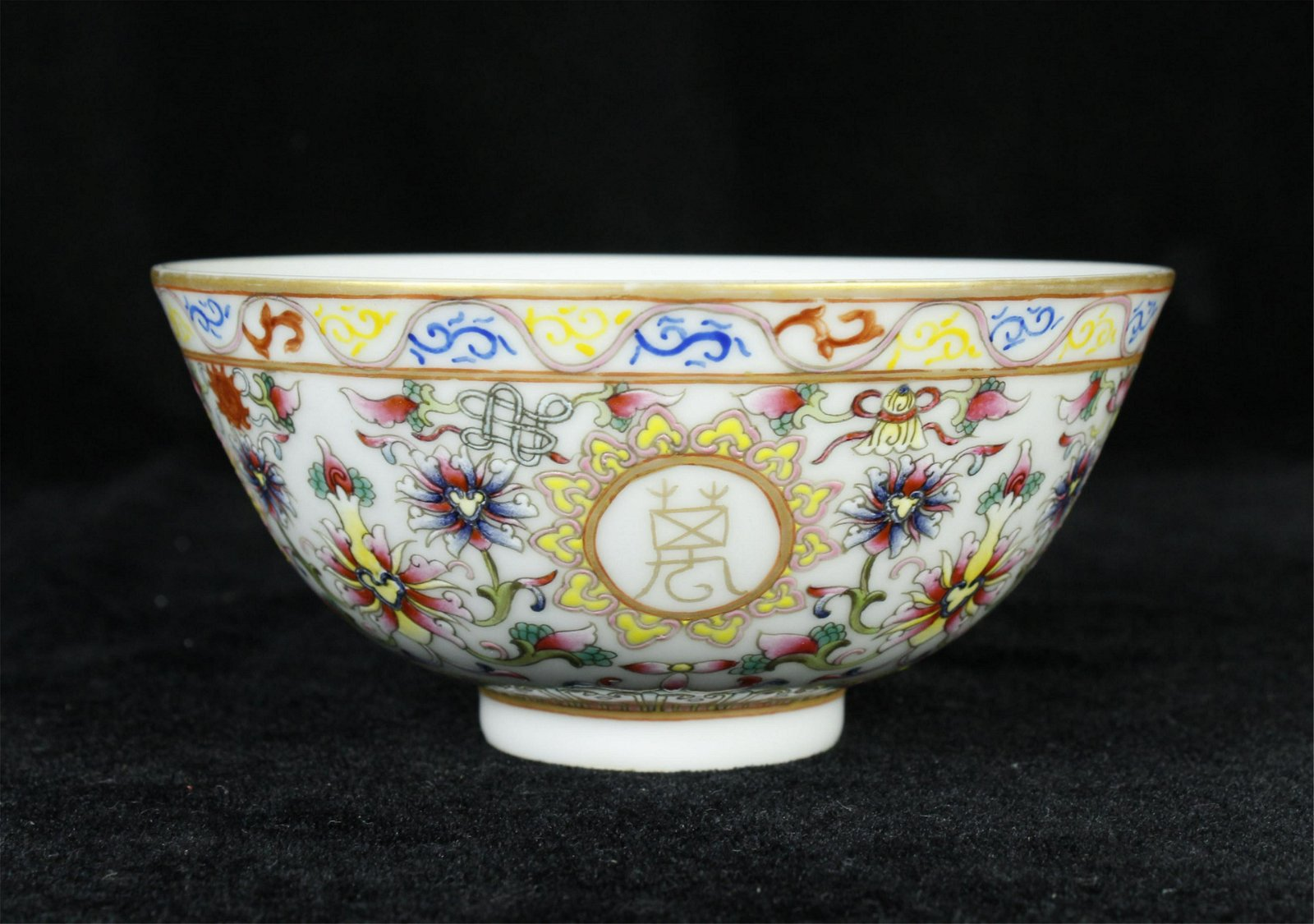 A CHINESE PORCELAIN  FAMILLE ROSE FLOWER AND POEM BOWL