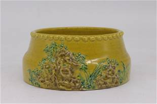 A CHINESE PORCELAIN THREE COLOR CARVED FLOWER BRUSH