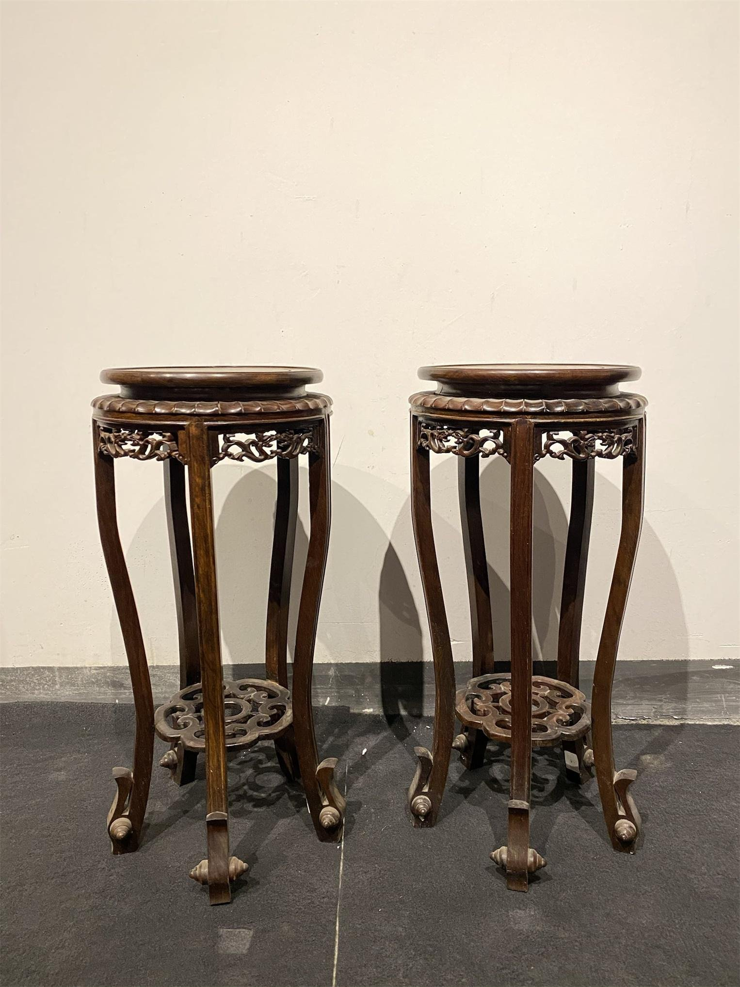 A Pair of Chinese Carved Hardwood Flower Stands