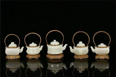 A Set of Chinese Carved Jade Teapots