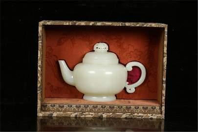 A Chinese Carved Jade Teapot