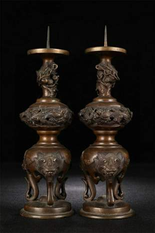 A Pair of Chinese Bronze Candlesticks