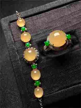 A Set of Chinese Carved Jadeite Bracelet and A Ring