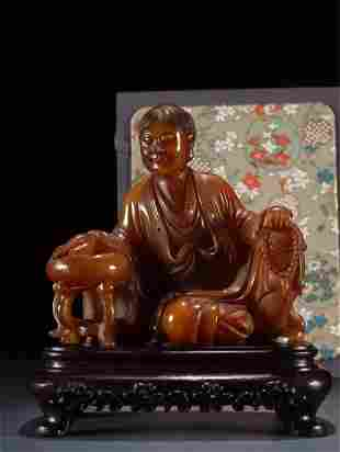 A Chinese Carved Stone Figure of Buddha