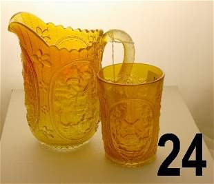 Carnival glass pitcher and tumbler depicting Dutch