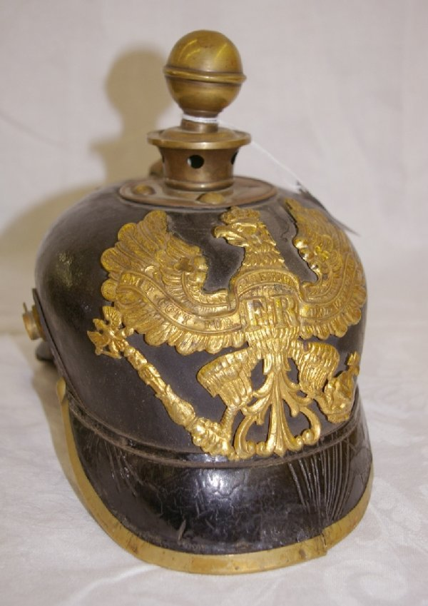 1012: WWI German Helmet, withbrass accents *noting leat