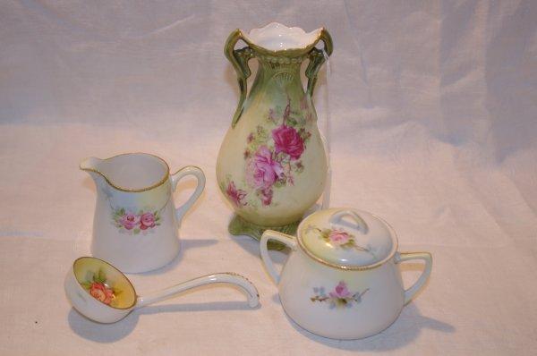 1010: Nippon ladle, nippon cream and sugar, measures 2