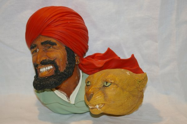 """1014: Bossons head of a man with a lion, measurse 8"""" x"""