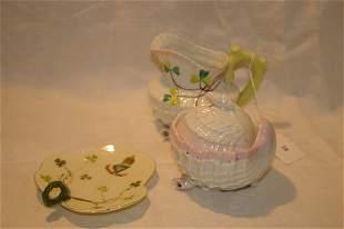 Belleek style cream and sugar and a porcelain nau