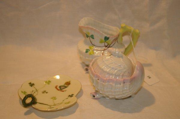 1018: Belleek style cream and sugar and a porcelain nau