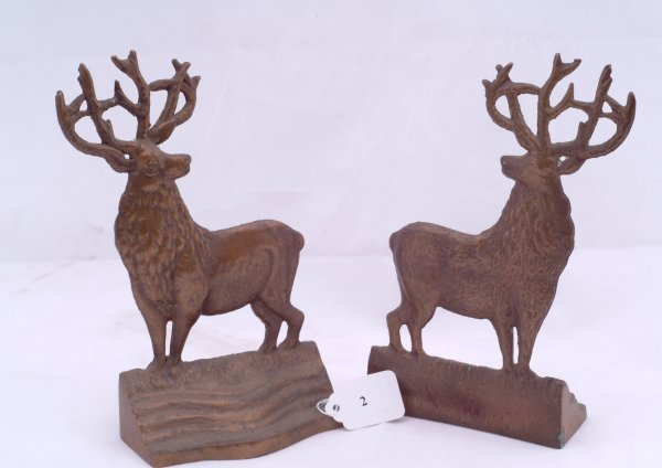 """2: Pair of buck bookends, measures 8"""" h."""