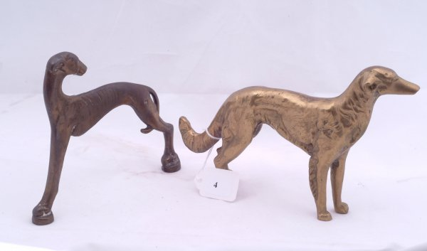 """4: Pair of brass dogs, measures 6"""" h."""