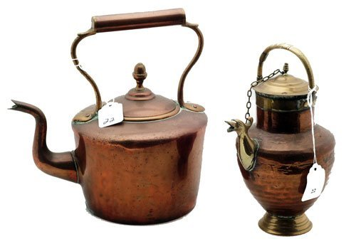 "22: Two Copper/Brass Kettles, measures 11"" h."