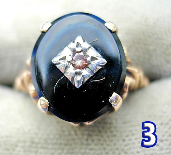 1003: Onyx and Synthetic Stone Ladies Ring