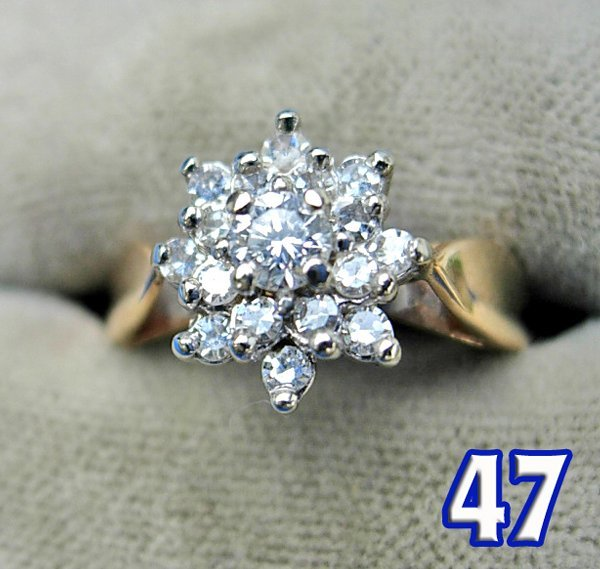 1047: Ladies 14 K Yellow Gold Diamond Cluster Ring