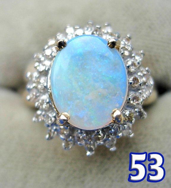 1053: Ladies 10 k Yellow Gold Opal &  Diamond Ring