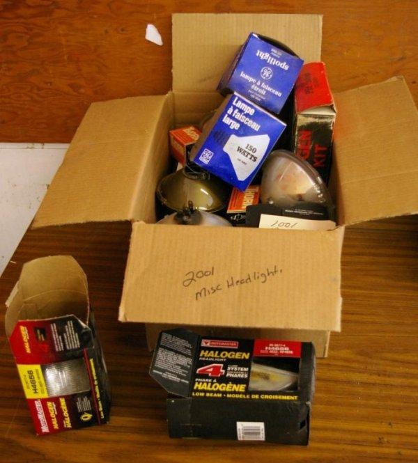 601: 1990 Box of Miscellaneous Headlights