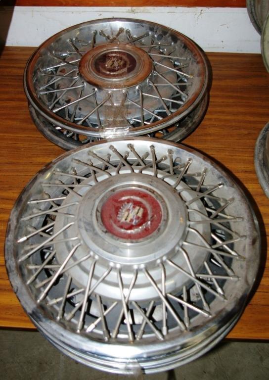 602: Five Cadillac Wire Wheel Disks