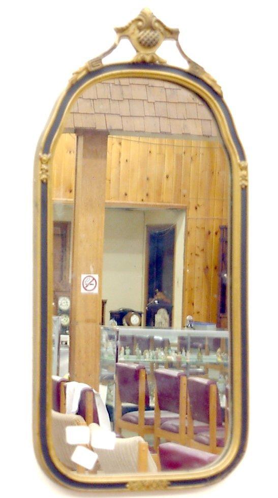 "1014: Metal framed mirror, measures 23 1/2"" l."