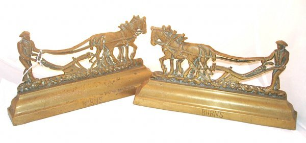 1018: Pair of Brass bookends, signed Greenlees Glasgow,
