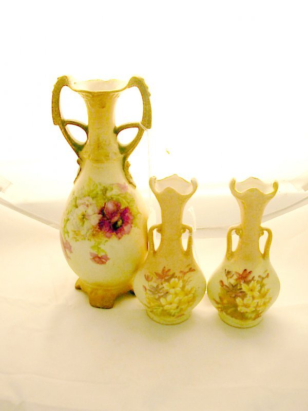 2005: Handpainted porcelain vase and a pair of small ha
