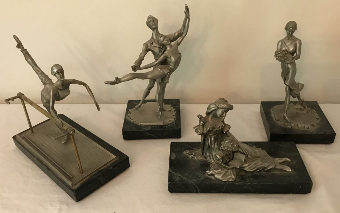 Grouping of 4 Pewter Sculptures