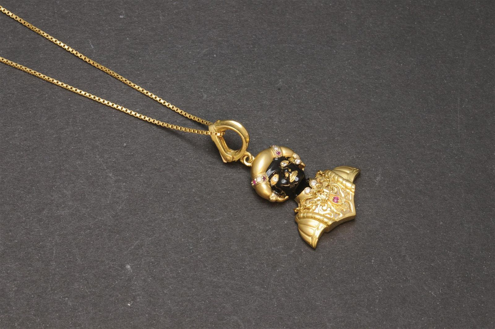 Moretto gold, enamel and diamond pendant