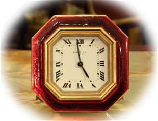 Fine Cartier travel alarm clock with red enamel frame,