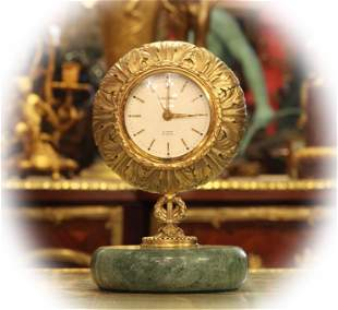 Looping table clock with eight days alarm,bronze