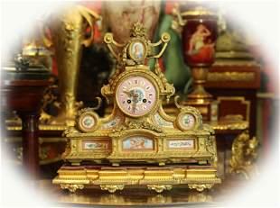 19 C Dore gilt metal and porcelain mantel clock