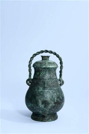 chinese bronze taotie-mask handled pot