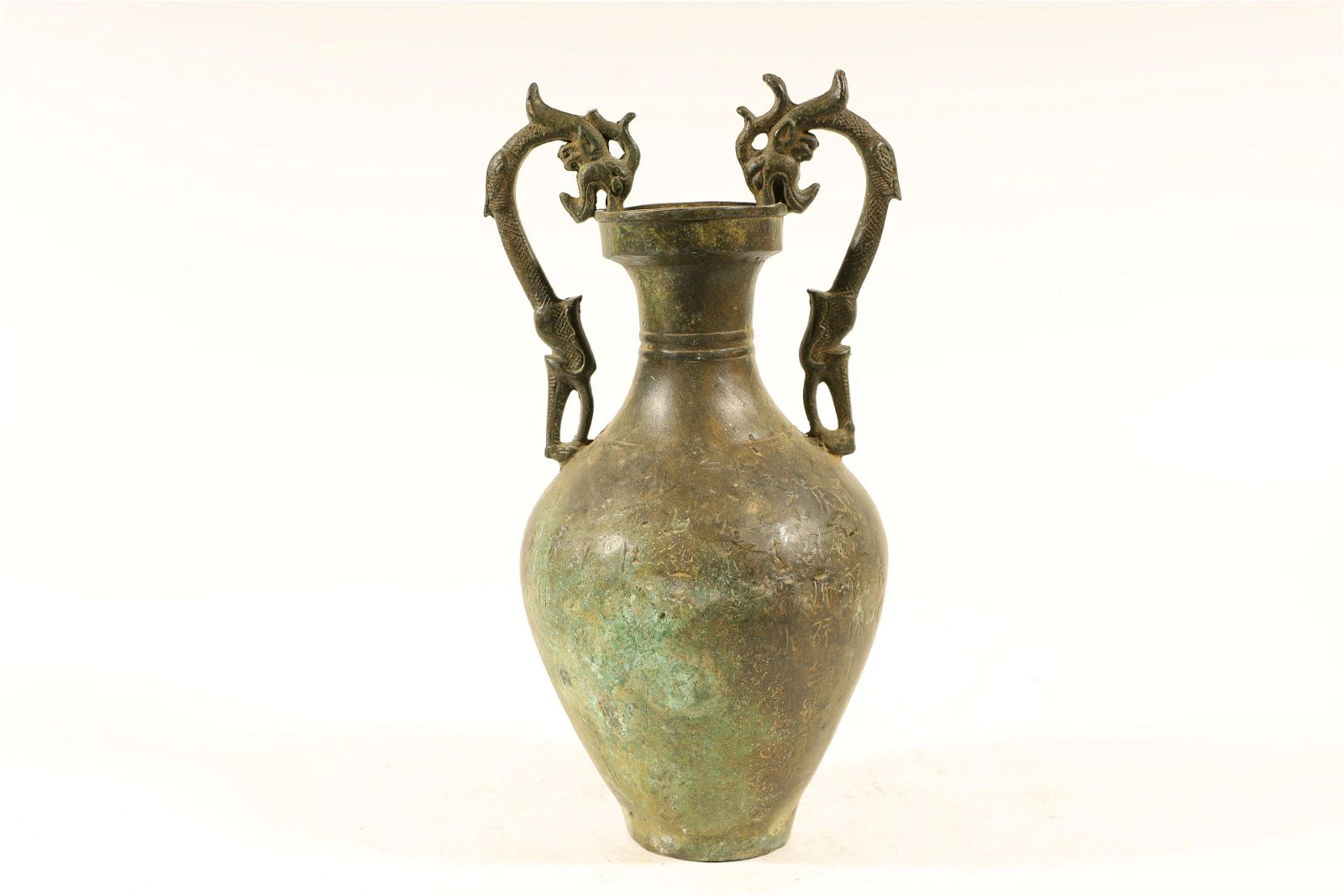 A Ming Dynasty bronze dragon vase with poem