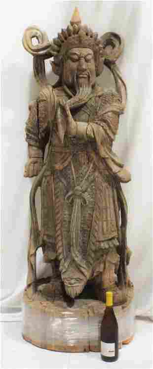 This Chinese antique carved wood figure depicting the