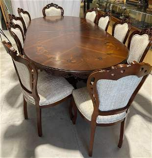 Extensive dining table with chairs