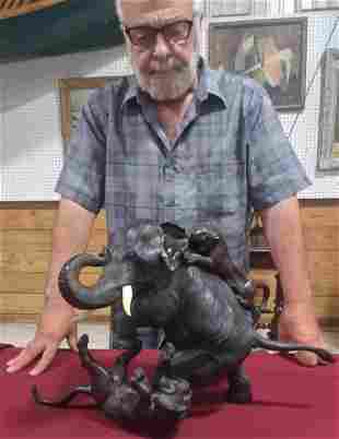 Vintage sculpture of two tigers attacking elephant