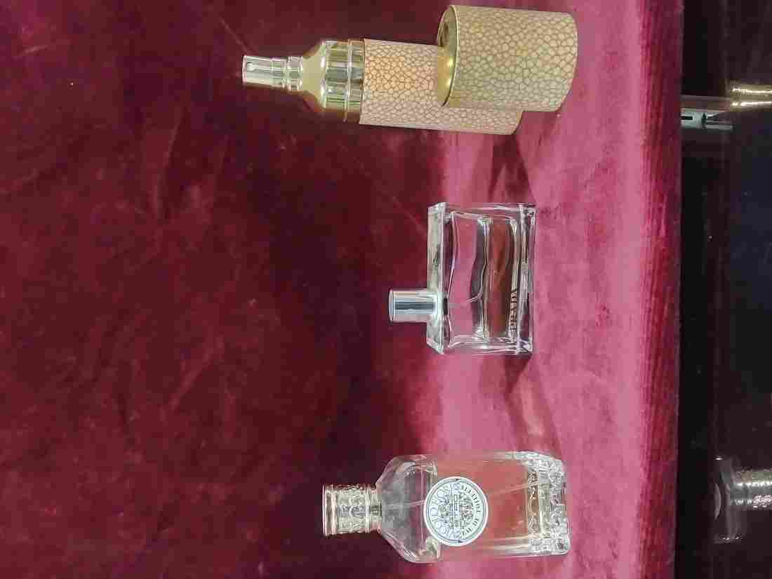 3 bottles of partially used perfume