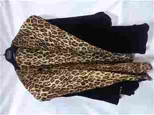Animal print black reversible coat no maker to be found