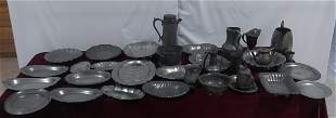 Large lot of pewter serving pieces