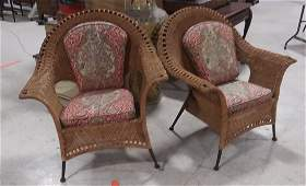 Pair of wicker chairs with cushions