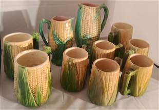 10 piece lot of Corn Majolica pitchers and mugs