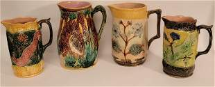 Lot of 4 large Majolica pitchers various designs