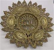 A brass Passover plate, D.27cm