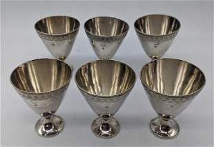 A set of 6 Middle Eastern silver shot cups, each