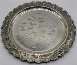 A silver Vietnamese circular dish with central