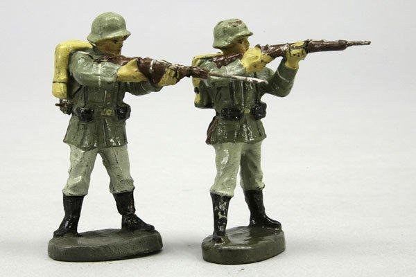 1011: 2 Soldaten, stehend schießend, E und Bellum, L 7,