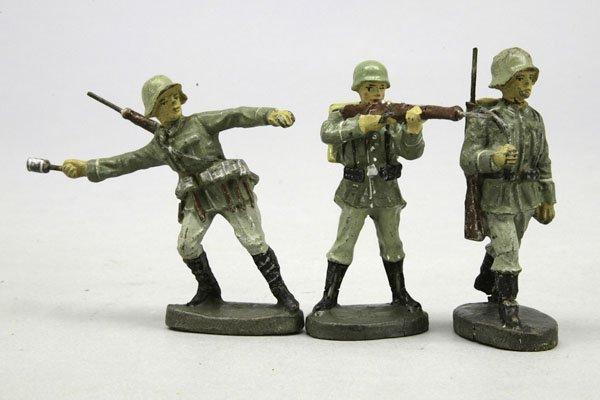1014: 3 E Soldaten, mit Tornister, im Marsch, stehend s
