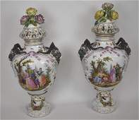 Pair of Meissen style porcelain lidded urns