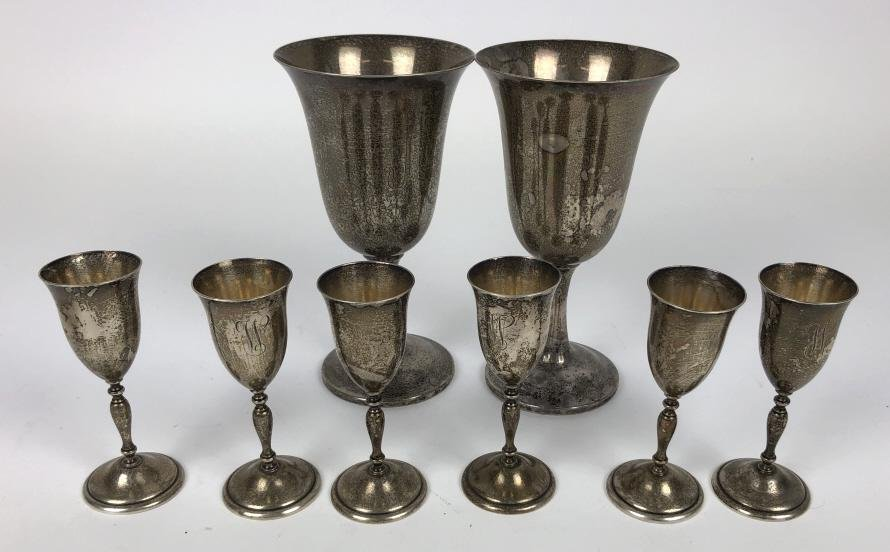 Pair of sterling silver wine goblets