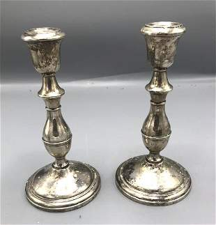 Pair of weighted sterling silver candlesticks